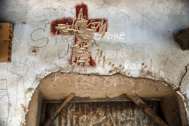 A painted cross is seen inscribed above the entrance of a room May 10 in a compound once occupied by Boko Haram in northeastern Nigeria. (CNS photo/Akintunde Akinleye, EPA)