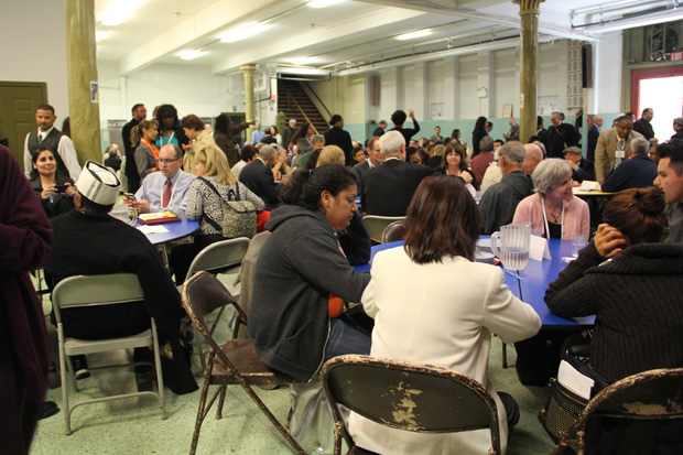 Participants at the start of a two-day conference by the mostly Catholic PICO community organizing network meet for discussions in the parish hall at Our Lady of Hope Church April 30 in North Philadelphia. (Photo by Margaret Ernst)