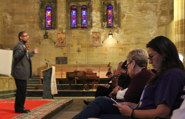 A speaker presents his views for participants of the PICO conference and residents of the North Philadelphia community April 30 at Our Lady of Hope Church, Philadelphia. Margaret Ernst)
