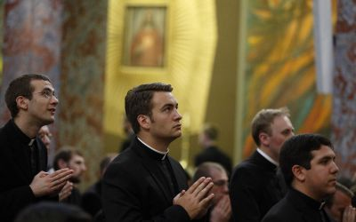 Seminarians attend Pope Francis' celebration of Mass at the Pontifical North American College in Rome May 2. (CNS photo/Paul Haring)