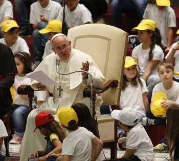 "Pope Francis leads an audience with children from the Fabbrica della Pace group in Paul VI hall at the Vatican May 11. In English the group is called the ""Peace Factory."" The initiative seeks to promote peace, tolerance and inclusion in Italian elementary schools. (CNS photo/Paul Haring)"