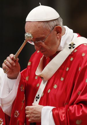 Pope Francis blesses himself with holy water as he celebrates Pentecost Mass in St. Peter's Basilica at the Vatican May 24. (CNS photo/Paul Haring)