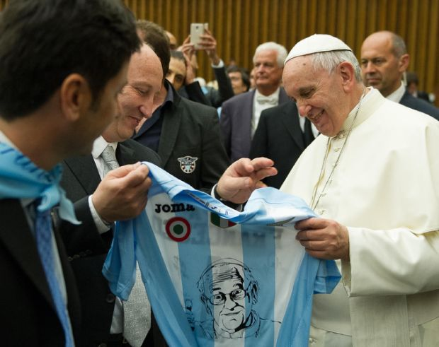 Pope Francis holds a jersey offered to him as a gift after leading a special audience for the Lazio sport association in Paul VI hall at the Vatican May 7. (CNS photo/L'Osservatore Romano)