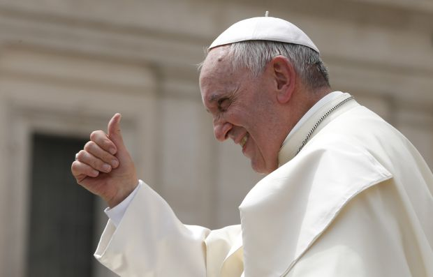 Pope Francis gives a thumbs up as he leaves his general audience in St. Peter's Square at the Vatican May 6. (CNS photo/Paul Haring)