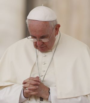 Pope Francis prays during general audience in St. Peter's Square at Vatican
