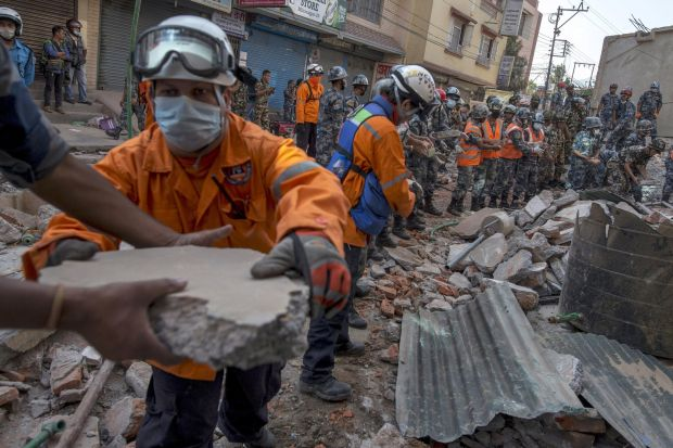 Nepalese military personnel remove debris in Kathmandu, Nepal, in search for survivors after an earthquake struck  (CNS photo/Athit Perawongmethar, Reuters)