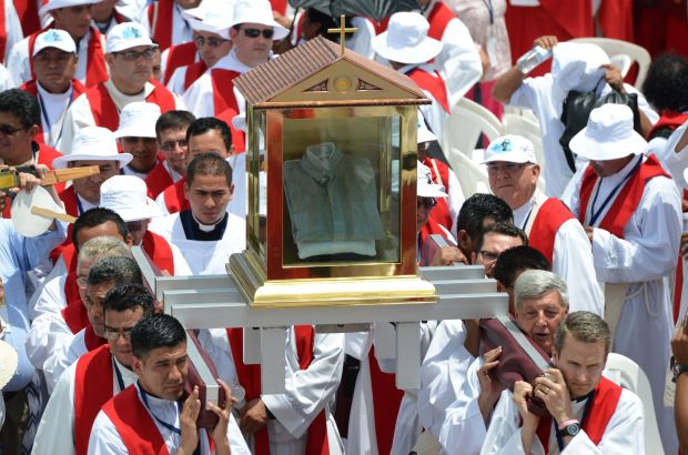 Priests carry the blood-stained shirt of Archbishop Oscar Romero during his beatification Mass at the Divine Savior of the World square in San Salvador May 23. (CNS photo/Lissette Lemus)