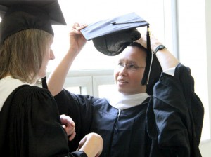 Sr. Theresa Josephine Thien-An Do, O.P. figures out how to wear her cap over her veil