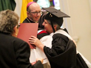 Christine Rizzo can't resist hugging Mother Assumpta Long, O.P. after she recives her Master of Arts Degree