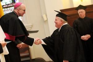 Thomas Joseph Gilmartin recives his Roman Catechetical Diploma from Bishop Senior as Jacob A. Marquart, III looks on