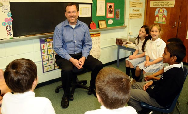 Patrick Reilly, president and CEO of the Cardinal Newman Society, visits with fourth graders of Regina Coeli Academy in Abington.