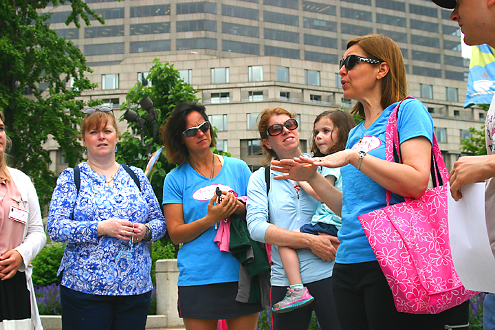 Organizer Jillian Buhl, right, explains the rosary walk to participants including Ginny East and her daughter Kate, members of St. Patrick Parish in Malvern, next to Buhl.