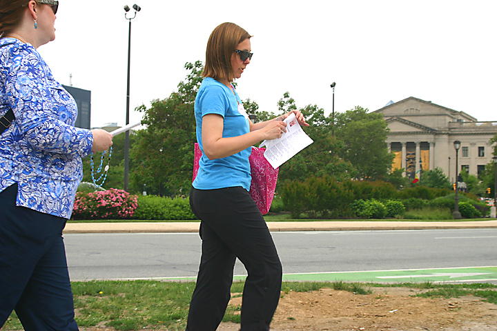 Jillian Buhl, center, prays as she walks along Logan Circle with Geri McCann of St. Denis Parish in Havertown.