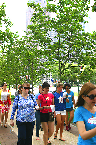 The participants in the walking rosary pray and sing under the shade trees of the Benjamin Franklin Parkway and the shadow of center city's skyscrapers.