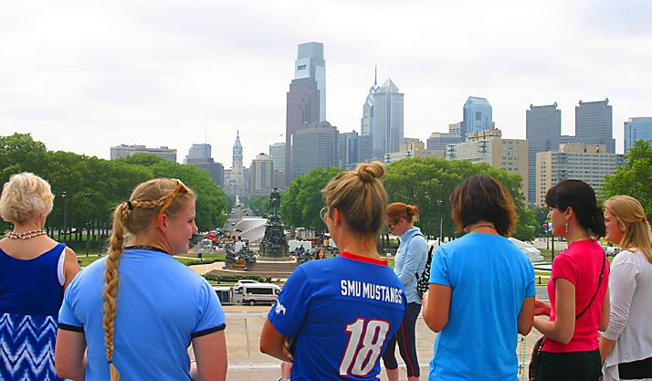 A group of women concludes praying the rosary together at the top of the Philadelphia Museum of Art's iconic steps overlooking the center city Philadelphia skyline May 27. Pope Francis will have a similar view -- including more than 1 million people -- when he celebrates Mass here Sept. 27. (Matthew Gambino)