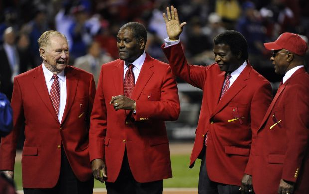 In this 2011 file photo, St. Louis Cardinals Hall of Famer Red Schoendienst, left, stands with other Cardinals legends Bob Gibson, Lou Brock and Ozzie Smith on the field prior to the start of game six of the World Series between the St. Louis Cardinals and the Texas Rangers at Busch Stadium in St. Louis.  (CNS photo/Tannen Maury, EPA)