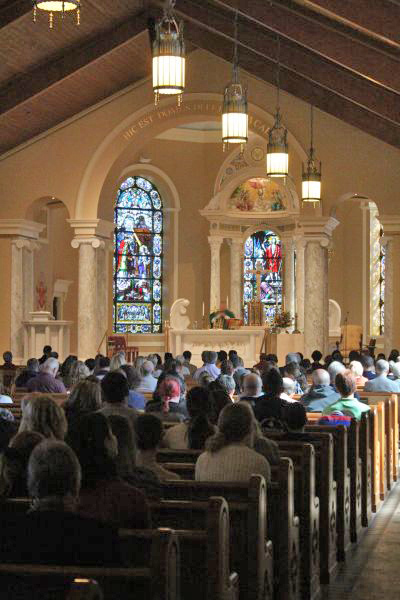 The interior of St. Bede Church during Mass.