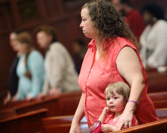 Makenzie Huggard attends mass with her mother Aimee Huggard