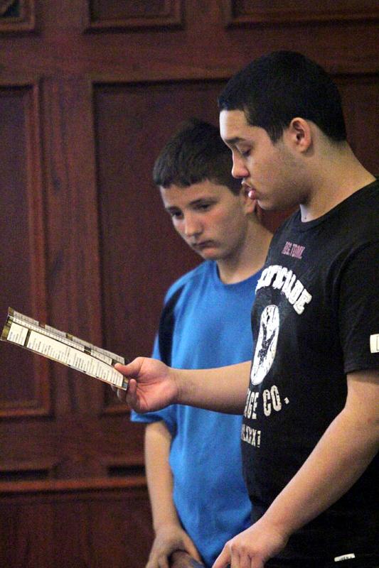 friends Ethan Walker and Stephen Zusin pray together