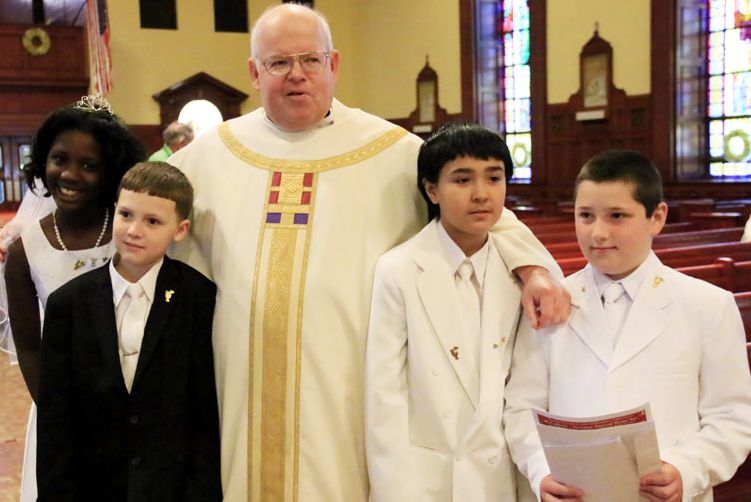 Pastor John LaRosa with the PREP first communicants after mass