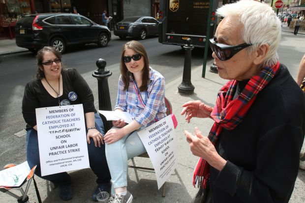Retired teacher Magdalena Vitug chats with striking teachers Anna Mavrianos, left, and Nora Murphy near the entrance of Transfiguration School in the Chinatown section of New York City May 5. The Federation of Catholic Teachers, the union that represents more than 2,600 teachers in the Archdiocese of New York, has authorized rolling one-day strikes at archdiocesan schools to protest what it believes are unfair labor practices by the archdiocese. (CNS photo/Gregory A. Shemitz)