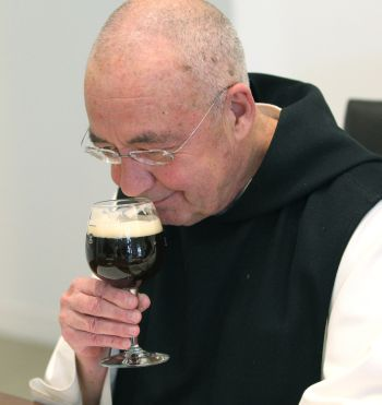 Trappist Father Isaac Keeley takes a whiff of Spencer Trappist Ale during an April 29  taste testing. (CNS photo/Chaz Muth)