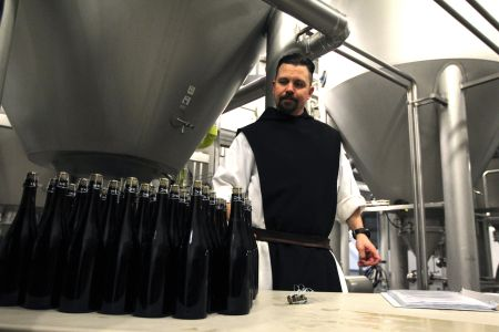 Trappist Brother Jonah Pociadlo counts bottles of Spencer Trappist Ale April 29 at the new state-of-the-art brewery on the grounds of St. Joseph's Abbey in Spencer, Mass. (CNS photo/Chaz Muth)
