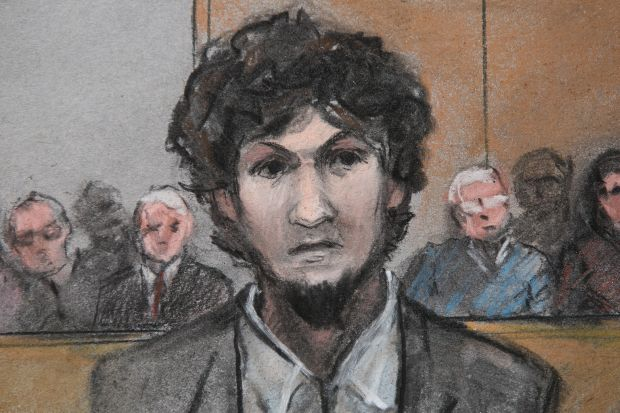 In this courtroom sketch, convicted Boston Marathon bomber Dzokhar Tsarnaev stands as he is sentenced to death at the U.S. courthouse in Boston May 15. (CNS illustration, Jane Flavell Collins, EPA)