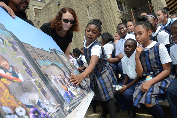 Students of St. Malachy School inspect the design of the mural May 28 that will be installed at their new school building in North Philadelphia. The mural will commemorate the visit of Pope Francis to Philadelphia in September. (Photo by Sabina Pierce)
