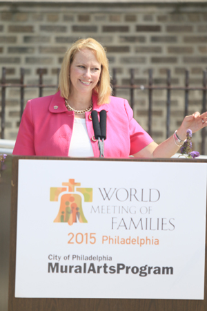 Donna Crilley Farrell, executive director of the World Meeting of Families, discusses the mural project May 28 at St. Malachy School in North Philadelphia. (Sarah Webb)