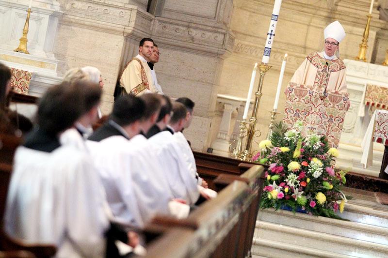 after mass Bishop Senior address the men