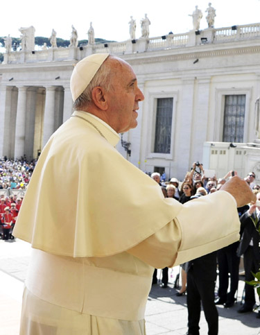 Pope Francis prays in St. Peter's Square at the Vatican May 13. (CNS photo/L'Osservatore Romano, pool)