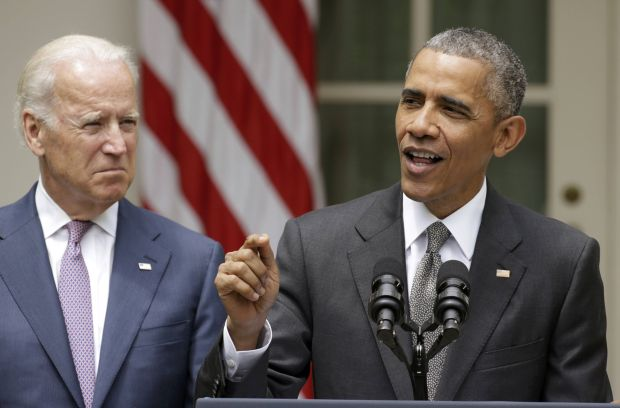 U.S. President Barack Obama, with Vice President Joe Biden  next to him, delivers remarks June 25 after the Supreme Court ruled 6-3 to uphold tax subsidies for participants in health exchanges run by the federal government in states that refused to create them. Obama and Biden are seen in the Rose Garden at the White House in Washington. (CNS photo/Gary Cameron, Reuters)