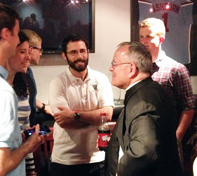 "Archbishop Chaput talks with young adults at the ""Chat with Chaput"" event June 4 at the Field House in Philadelphia. (Facebook)"