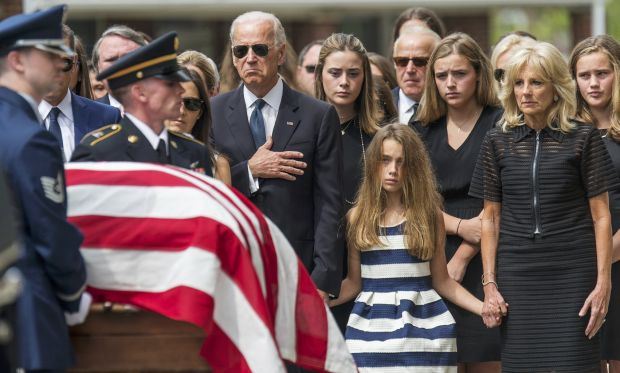 U.S. Vice President Joe Biden puts his hand on his heart June 6 as he and other family members watch soldiers carry the casket with the body of Beau Biden into St. Anthony of Padua Church in Wilmington, Del.  (CNS photo/Bryan Woolston, Reuters)