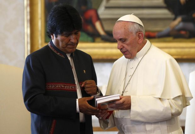 Pope Francis exchanges gift with Bolivian President Evo Morales during a private audience at the Vatican Sept. 6. Pope Francis is scheduled to visit Bolivia July 8-10 as part of a trip that will also include Ecuador and Paraguay. (CNS photo/Riccardo De Luca, pool via EPA)