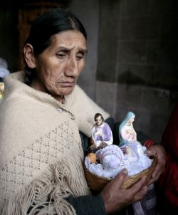 A woman carries figurines of Joseph and Mary after a 2011 Mass for the feast of the Epiphany in La Paz, Bolivia. (CNS/David Mercado, Reuters)