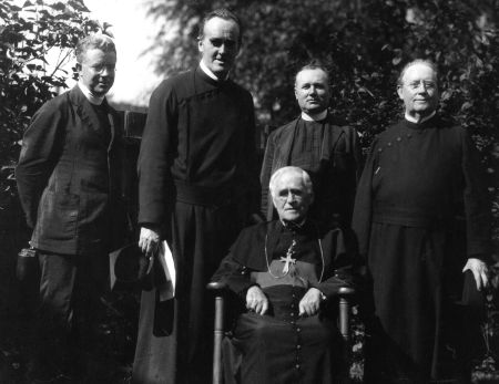 Paulist priests pose for this 1913 photo with Toronto Archbishop Neil McNeil, who is seated, on the campus of the University of Toronto. Without enough priests, the U.S.-based Paulists have decided to leave Canada after a century of ministry. (CNS photo/courtesy of the Paulists)