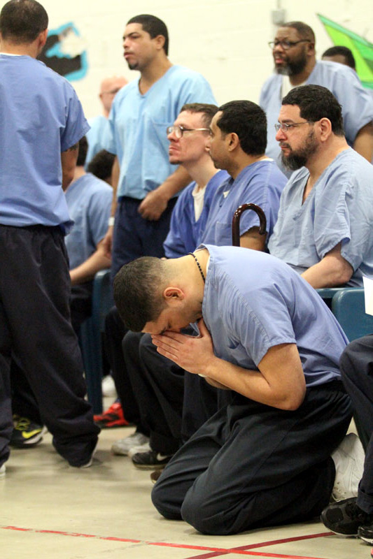 Prisoners at Crran-Fromhold Correctional Facility pray during a visit by Archbishop Chaput in January 2015. (Sarah Webb)