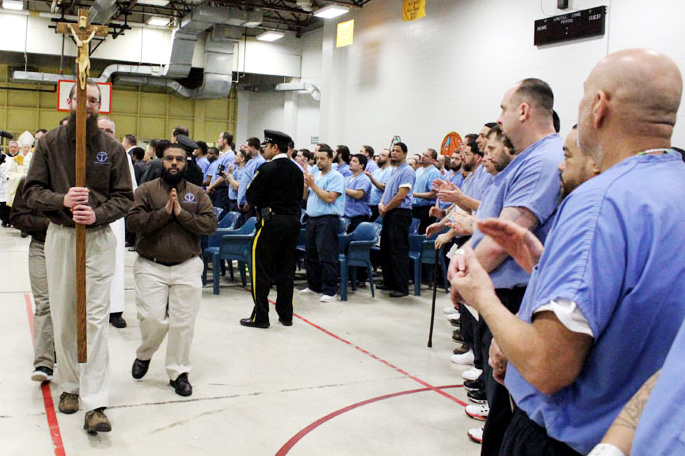Prisoners at Curran-Fromhold Correctional Facility sing, clap and praise the Lord in a liturgy celebrated by Archbishop Charles Chaput last January. Pope Francis will visit the prison during his stay in Philadelphia this September. (Sarah Webb)