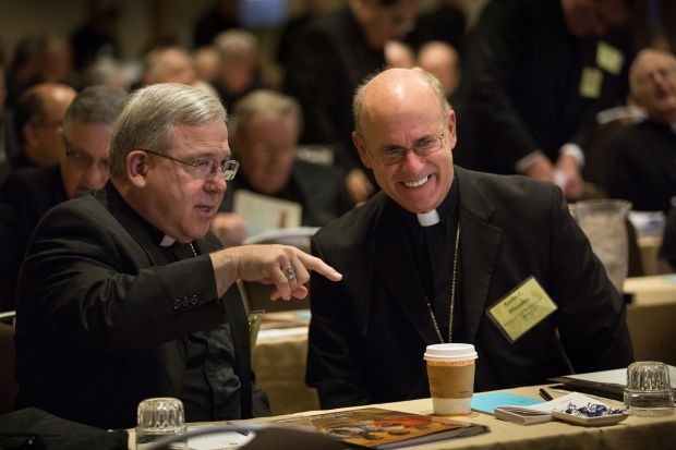 Bishop Joseph R. Cistone of Saginaw, Mich., speaks with Bishop Kevin C. Rhoades of Fort Wayne-South Bend, Ind., June 10 at the annual spring general assembly of the U.S. Conference of Catholic Bishops in St. Louis. (CNS photo/Lisa Johnston, St. Louis Review)