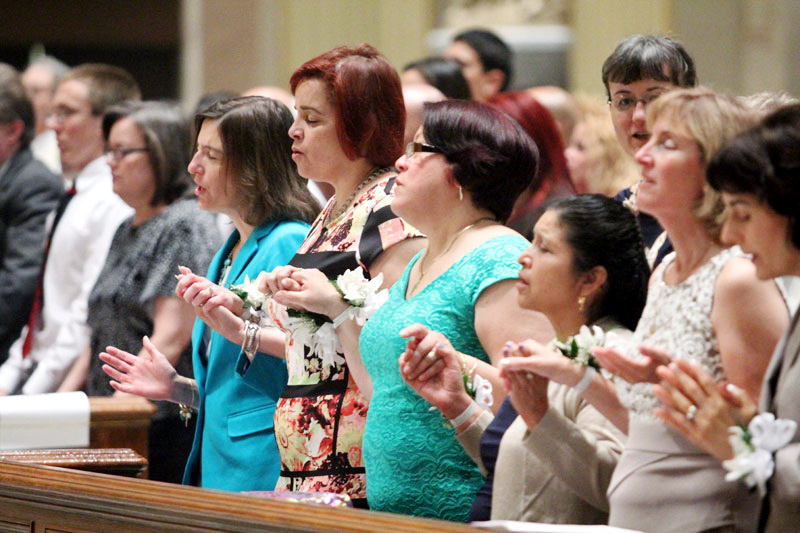 wives of the deacons hold hands as they pray the Lord's Prayer
