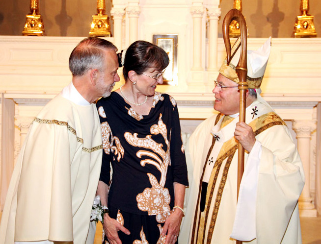 Mark J. Kuhn and his wife Suzanne chat the archbishop after mass