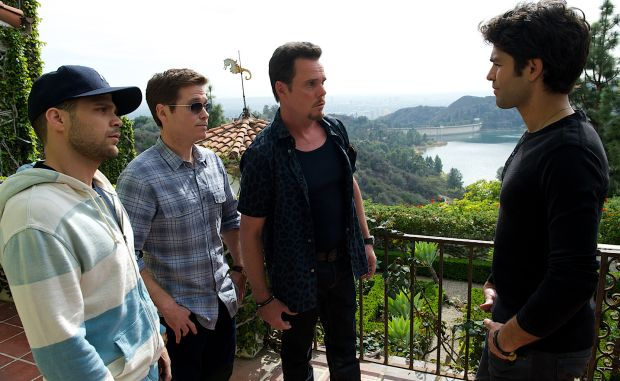 "Jerry Ferrara, Kevin Connolly, Kevin Dillon and Adrian Grenier star in a scene from the movie ""Entourage.""  (CNS photo/Warner Bros.)"