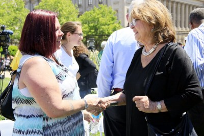 Anne Marie Jones (left) a former resident and advocate for the women's shelter Dawn's Place, speaks with Emily Riley of the Connelly Foundation and a member of the Hunger and Homeless Committee, after the press conference June 22. (Sarah Webb)