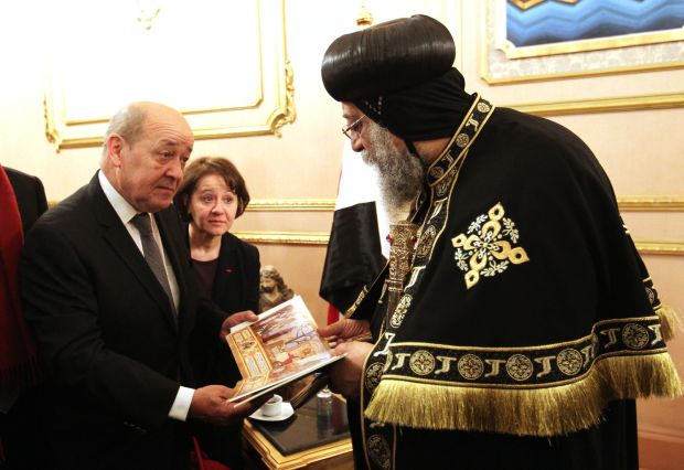 French Defense Minister Jean-Yves Le Drian offers his condolences to Pope Tawadros II of Alexandria, patriarch of the Coptic Orthodox Church, at the Coptic cathedral in Cairo in late February.  (CNS photo/Khaled Elfiqi, EPA)