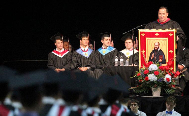 Chris Mominey addresses the graduates