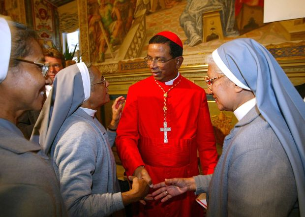 Cardinal Telesphore Toppo talks with nuns at the Vatican in this October 2003 file photo. New Delhi police arrested a man in connection with an early June death threat against the cardinal. (CNS photo/Danilo Schiavella, EPA)