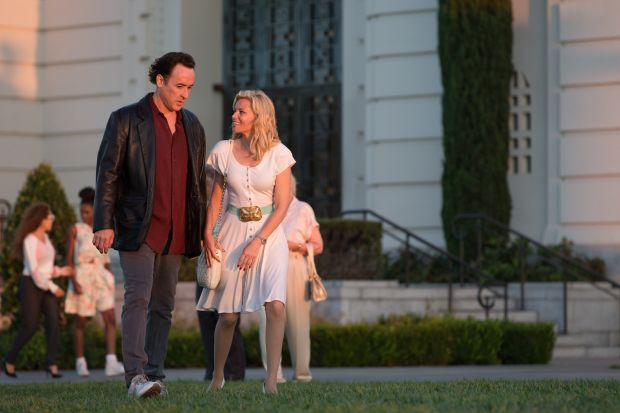 "John Cusack and Elizabeth Banks star in a scene from the movie ""Love & Mercy."" The Catholic News Service classification is A-III -- adults. The Motion Picture Association of America rating is PG-13 -- parents strongly cautioned. Some material may be inappropriate for children under 13. (CNS photo/Roadside Attractions) See MOVIE REVIEW June 10, 2015."