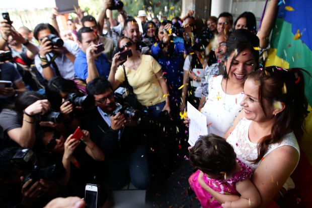 In this Dec. 14, 2013 file photo, a same-sex couple marries in Jalisco, Mexico. (CNS photo/Ulises Ruiz Basurto, EPA)